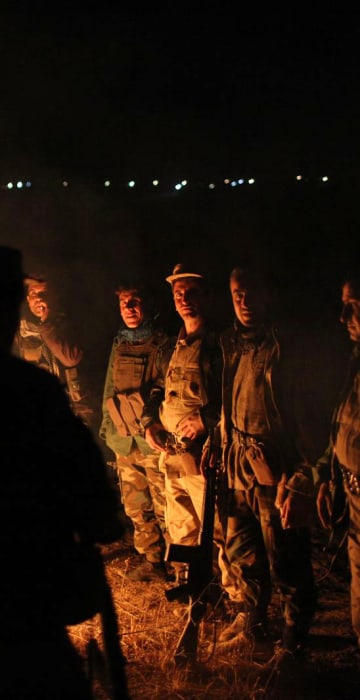 Peshmerga soldiers gather the night before an offensive starts to retake Mosul, near the Ba'ashiqah front line in Iraq on Oct. 19.