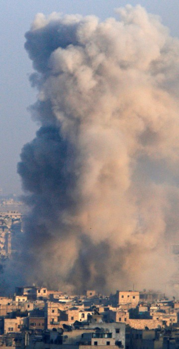 Image: Smoke rises as seen from a government-held area of Aleppo