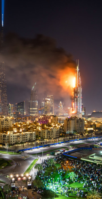 Image: Flames and smoke after a fire broke out at the The Address Hotel in Dubai