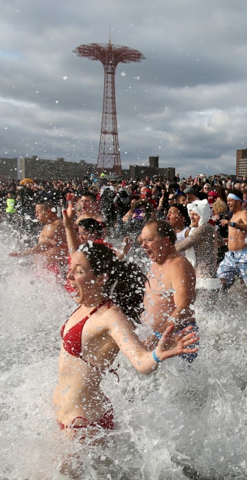 Image: Participants enter the water during the Coney Island Polar Bear Club's annual New Year's Day swim at Coney Island in the Brooklyn borough of New York.