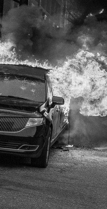 Image: A parked limousine burns during a demonstration after the inauguration of President Donald Trump on Jan. 20 in Washington. D.C.