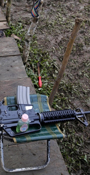 Image: 3-month-old Junior Alexis Patino, son of FARC rebel Deisy Garcia, sleeps next to his mother's weapon at a rebel camp
