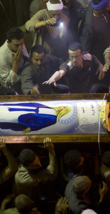 Image: Relatives of Coptic Christian Ayied Ward, who was a victim of an attack on a bus, carry his coffin following his funeral service