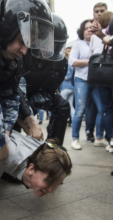 Image: Police detain a protester in Moscow