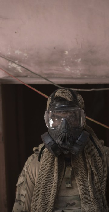Image: An Iraqi Special Forces soldier wears a gas mask after an alleged chemical attack during fighting against Islamic State militants on June 30.