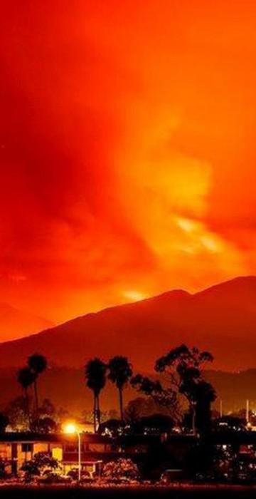 Image: Smoke is illuminated by the Whittier wildfire near Santa Ynez