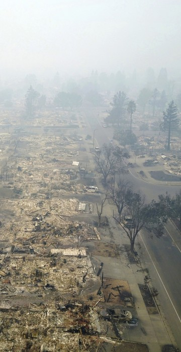 Image: This aerial image shows a neighborhood that was destroyed by a wildfire in Santa Rosa, Calif.,