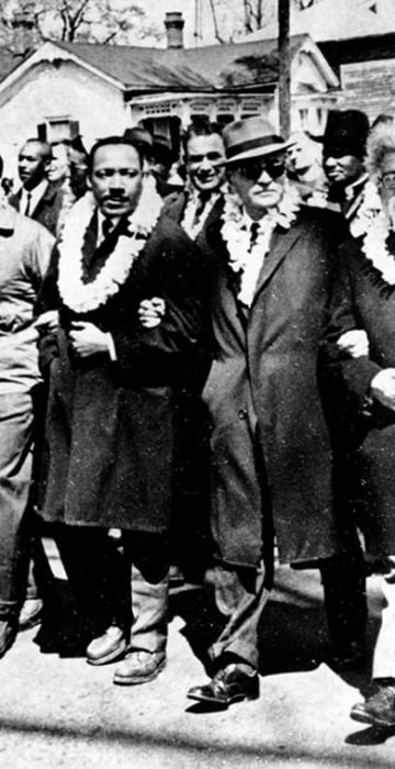 Image: The Rev. Martin Luther King Jr. links arms with other civil rights leaders
