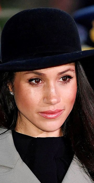 Meghan Markle, the US fiancee of Britain's Prince Harry, attends an Anzac Day dawn service at Hyde Park Corner in London on April 25, 2018. 