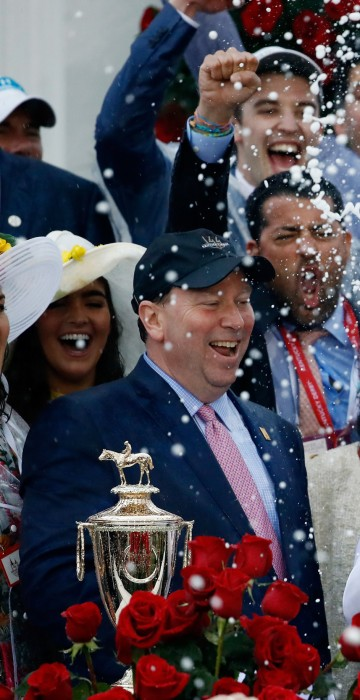 Image: Jockey Mike Smith celebrates after winning the 144th running of the Kentucky Derby