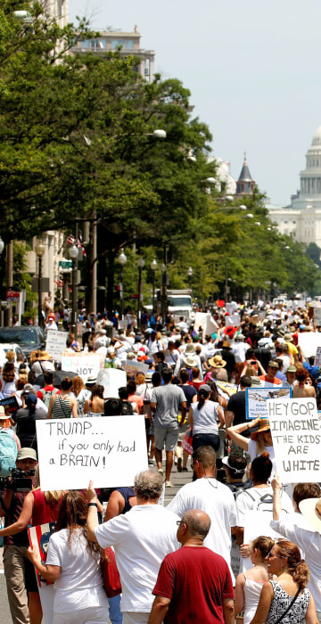 Image: Immigration activists march to protest the Trump Administration's immigration policy in Washington