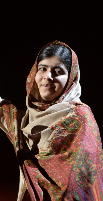 Baby Liberty dressed as Malala Yousafzai, Pakistani activist for female education and the youngest Nobel Prize laureate.