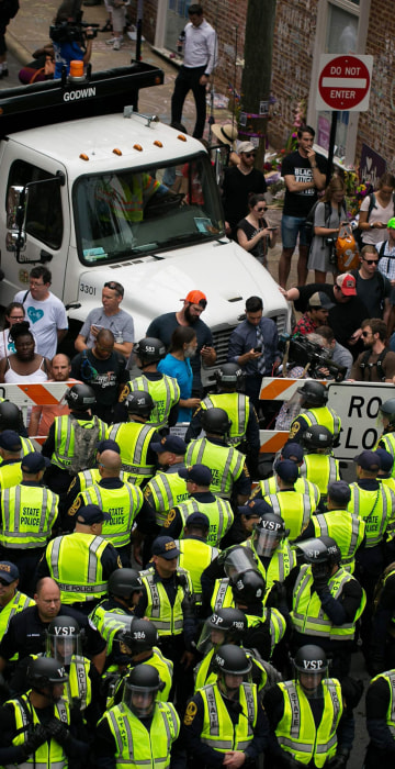2186b841dc96e Police and protesters come out in force on first anniversary of  Charlottesville