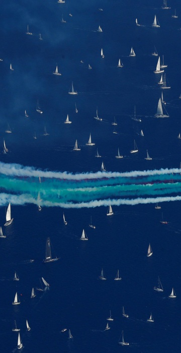 Image: The Italian Frecce Tricolori aerobatic squad performs before the start of the Barcolana regatta in front of the Trieste harbour