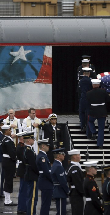 Image: A joint services military honor guard brings former President George H.W. Bush's casket onto a Union Pacific train.