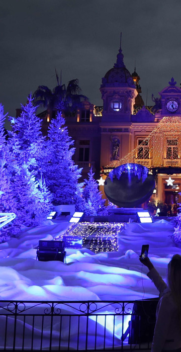 Image: People visit the Christmas lights and decoration display in front of the Monte-Carlo Casino