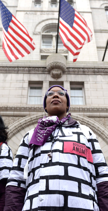 Image: Women wear wall protest outfits as they stand in front of the Trump International Hotel while participating in the Third Annual Women's March in Washington