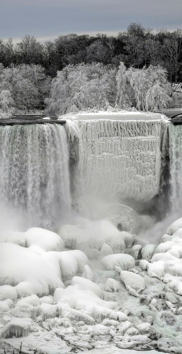 Image: Water flows around ice, formed around Niagara Falls due to subzero temperatures in Niagara Falls