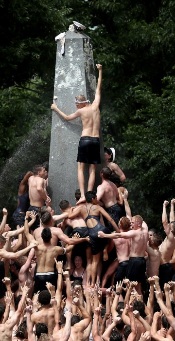 Image: *** BESTPIX *** Naval Academy Freshman Climb Greased Monument In Annual Rite Of Finishing First Year