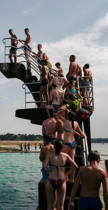 Image: TOPSHOT-FRANCE-WEATHER-HEAT-TOURISM-BEACH
