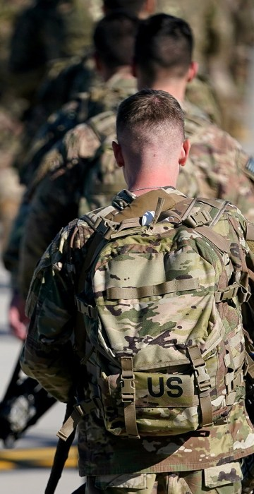 U.S. Army paratroopers assigned to the 1st Brigade Combat Team, 82nd Airborne Division, walk toward an awaiting aircraft prior to departing for the Middle East from Fort Bragg.