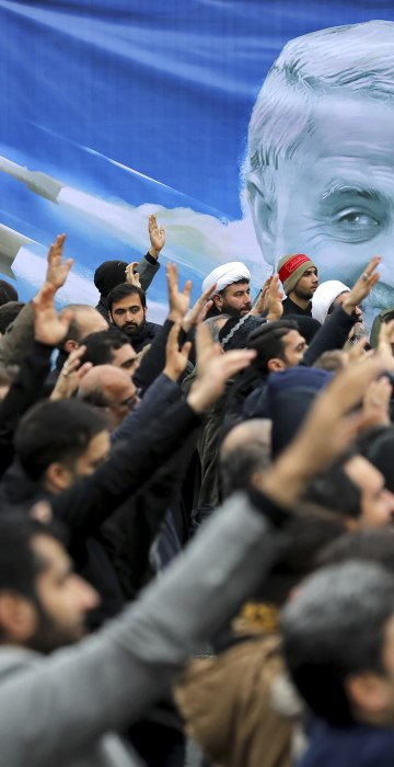 """Protesters demonstrate over the U.S. airstrike in Iraq that killed Iranian Revolutionary Guard Gen. Qassem Soleimani in Tehran, Iran, on Jan. 4, 2020. Iran vowed """"harsh retaliation"""" for the U.S. airstrike near Baghdad's airport that killed Tehran's top general and the architect of its interventions across the Middle East, as tensions soared in the wake of the targeted killing."""