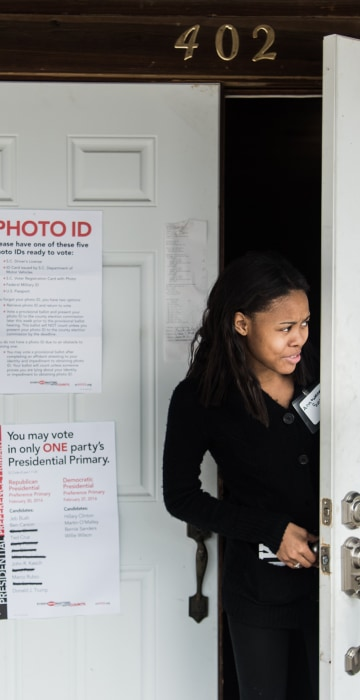 Image: A poll worker peeks out the door at American Legion Memorial Cayce Post 130