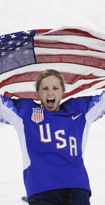 Image: Jocelyne Lamoureux-Davidson celebrates after Team USA defeated Canada in a 3-2 victory during the gold medal match on Feb. 22, 2018.