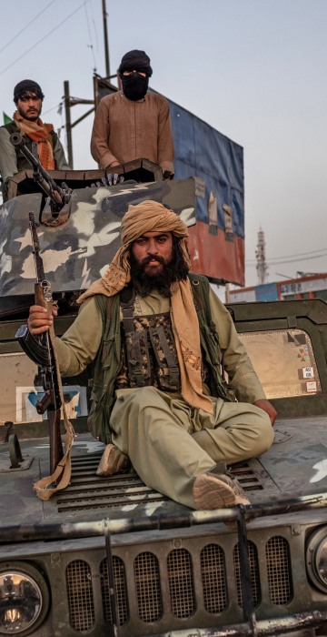 Taliban fighters on a Humvee in Kabul on Aug. 15, 2021.