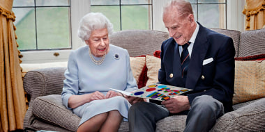 Image: Britain's Queen Elizabeth II and Britain's Prince Philip, Duke of Edinburgh look at a homemade wedding anniversary card