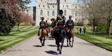 Image: Members of The Kings Troop Royal Horse Artillery arrive at Windsor Castle on the day of the funeral of Britain's Prince Philip, husband of Queen Elizabeth, who died at the age of 99, in Windsor