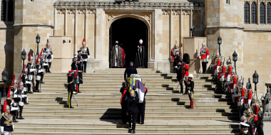 Image: The Duke of Edinburgh's coffin, covered with His Royal Highness's Personal Standard arrives at St George's Chapel carried by a bearer party found by the Royal Marines during the funeral of Prince Philip, Duke of Edinburgh at Windsor Castle