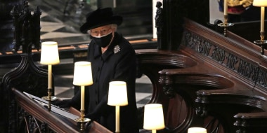 Image: Britain's Queen Elizabeth II takes her seat alone in St. George's Chapel during the funeral of Prince Philip, the man who had been by her side for 73 years, at Windsor Castle, Windsor, Englan