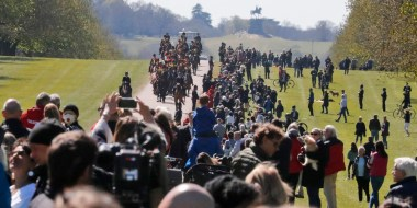 Image: People watch as King's Troup Royal Horse Artillery rides towards Windsor Castle in Windsor,