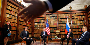 A security officer indicates to the media to step back as Secretary of State Antony Blinken, US President Joe Biden, Russia's President Vladimir Putin and Russia's Foreign Minister Sergei Lavrov meet in Geneva on June 16, 2021.