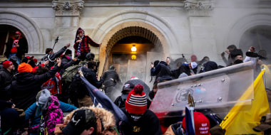Supporters of President Donald Trump clash with police and security forces at the Capitol on Jan. 6, 2021.
