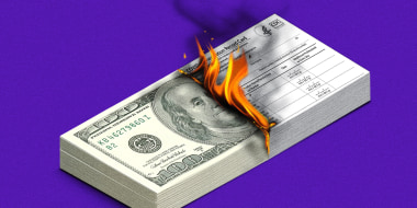 Illustration of a stack of $100 dollar bills as a stack of Covid-19 vaccination record cards burns away.