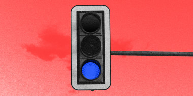 Photo illustration: A traffic light with a lit blue light instead of a green light.