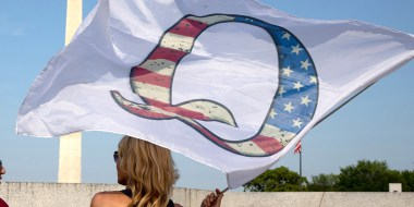 Image: QAnon supporters wait for the military flyover at the World War II Memorial during 4th of July celebrations in Washington.