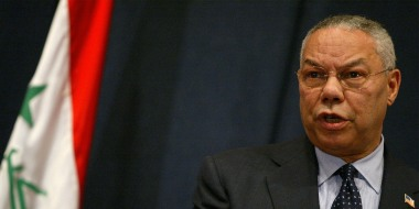 Image: Colin Powell speaking at a press conference in Baghdad.