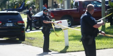 Police put up caution tape at the home of Brian Laundrie on Sept. 20, 2021, in North Port, Fla.