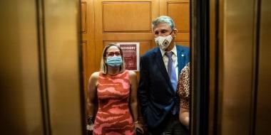 Image: Sen. Kyrsten Sinema, D-Ariz., and Sen. Joe Manchin, D-W. Va., on Capitol Hill on Sept. 30, 2021.