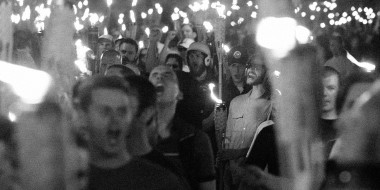 Image: People marching with tiki torches.