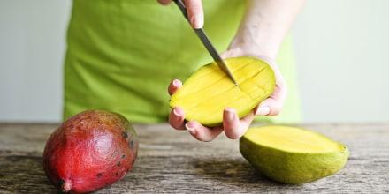 Hand Holding Fresh Mango