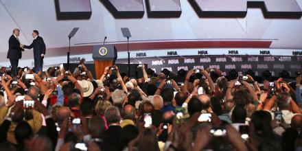 Image: President Donald Trump shakes hands with NRA Executive Vice President Wayne LaPierre