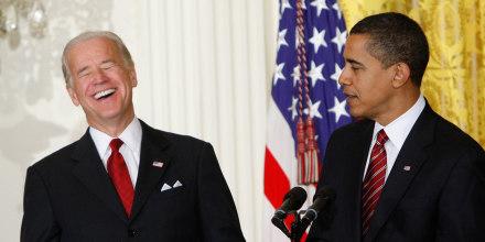 Image: Vice President Joe Biden laughs during a light moment as President Barack Obama speaks in the East Room of the White House