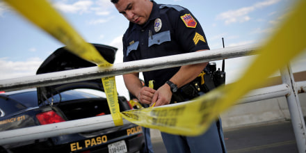Image: A police cordon is seen after a mass shooting at a Walmart in El Paso