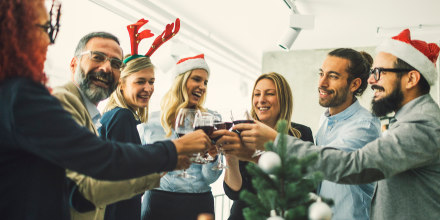 Image: Business people toasting with red wine at workplace