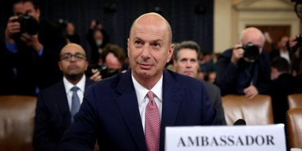 Image:  Ambassador to the European Union Gordon Sondland takes his seat to testify before a House Intelligence Committee on Nov. 20, 2019.