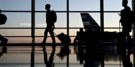 Image: Travelers walk through Ronald Reagan National Airport in Washington on Nov. 21, 2018.